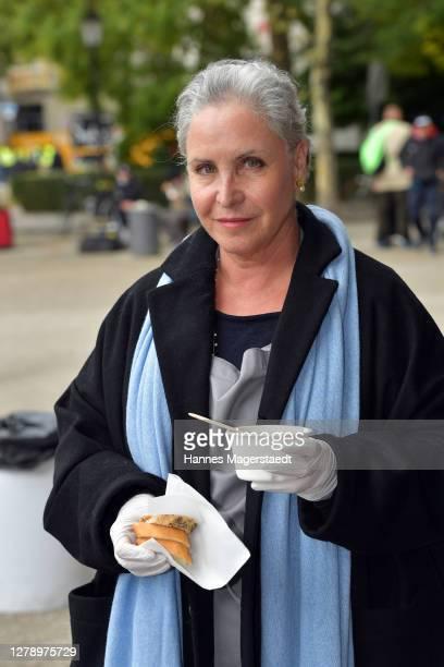Actress Katerina Jacob distributes hot meals to needy people organized by the local Caritas association Saint Korbinian Kitchen on October 07, 2020...