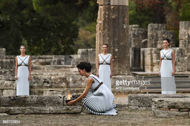 Actress Katerina Lechou acting the high priestess holds the Olympic flame at the Temple of Hera in Olympia the sanctuary where the Olympic Games were...