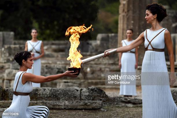 Actress Katerina Lechou acting the high priestess lights the Olympic flame at the Temple of Hera in Olympia the sanctuary where the Olympic Games...