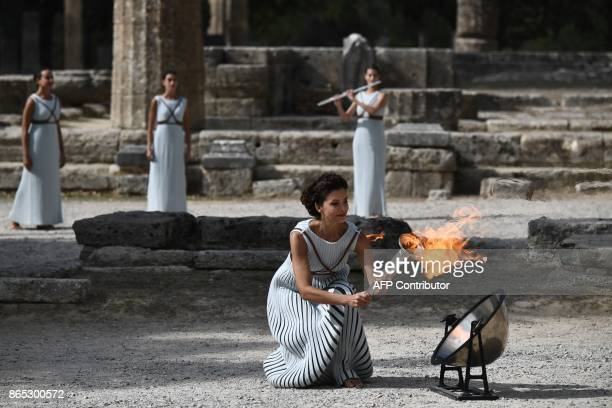 Actress Katerina Lechou acting the high priestess passes the Olympic flame at the Temple of Hera on October 23 2017 during a dressed rehearsal of the...