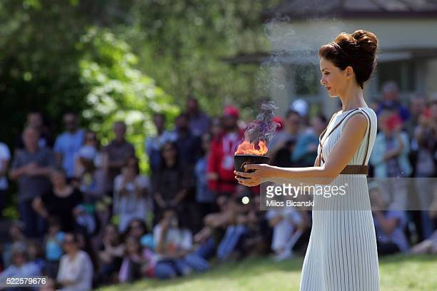 Actress Katerina Lechou acting the high pristess holds the Archaic Pot at the Ancient Stadium during the Rehearsal for the Lighting Ceremony of the...