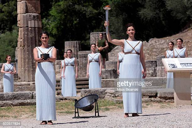 Actress Katerina Lechou acting the high pristess holds the Olympic Torch at the Ancient Stadium during the Rehearsal for the Lighting Ceremony of the...
