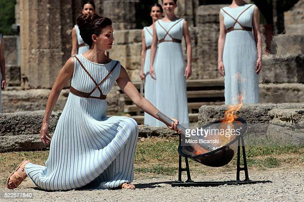 Actress Katerina Lechou acting the high pristess lights the Olympic Torch at the Ancient Stadium during the Rehearsal for the Lighting Ceremony of...