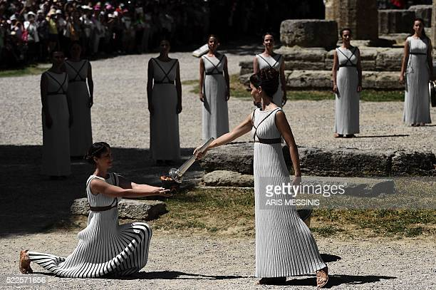 Actress Katerina Lechou acting the high pristess passes the Olympic flame at the Temple of Hera on April 20 2016 during a dress rehearsal of the...