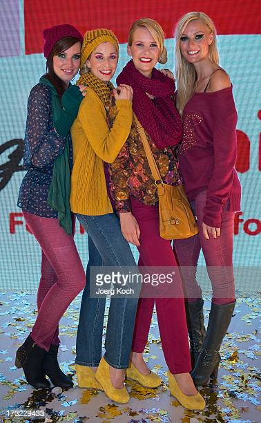 Actress Katharina Gast actress Tina Bordihn TVhost Monica Ivancan and stuntwoman Miriam Hoeller pose as models at the Ernsting's Family Fashion Show...