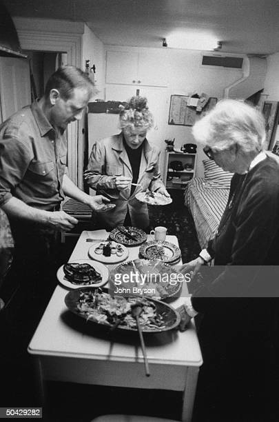 Actress Katharine Hepburn sharing lunch w her driver Howard Hildenbrand and secy Phyllis Wilbourn