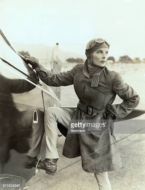 Actress Katharine Hepburn standing next to an aircraft for the film Christopher Strong