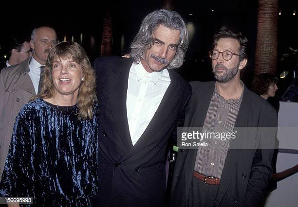 "Actress Katharine Ross, actor Sam Elliott and singer Eric Clapton attend the ""Rush"" Hollywood Premiere on December 18, 1991 at the General Cinema..."