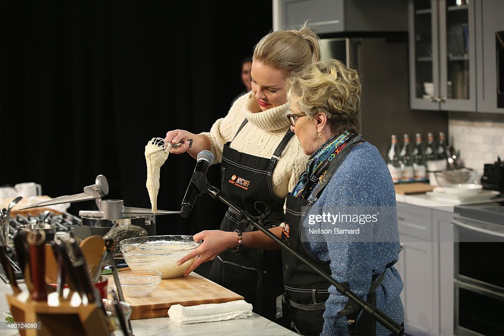 Actress Katherine Heigl (L) and Nancy Heigl cook onstage during the Grand Tasting presented by ShopRite featuring Samsung culinary demonstrations presented by MasterCard - Food Network & Cooking Channel New York City Wine & Food Festival presented by FOOD & WINE at Pier 94 on October 17, 2015 in New York City.