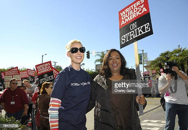 Actress Katherine Heigl and producer Chandra Wilson pose while marching to support the striking speak at the Writer's Guild of America's 'Diversity...