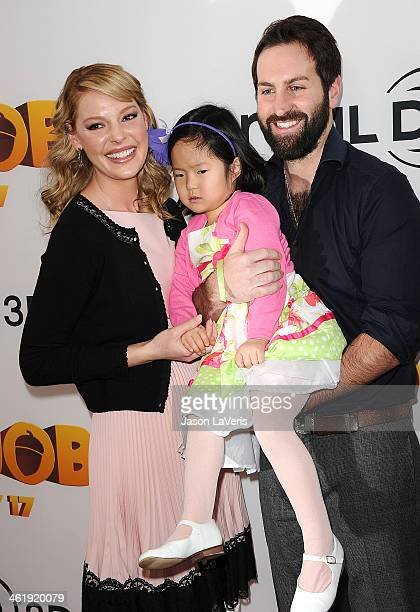 Actress Katherine Heigl husband Josh Kelley and daughter Nancy Naleigh Leigh attend the premiere of The Nut Job at Regal Cinemas LA Live on January...