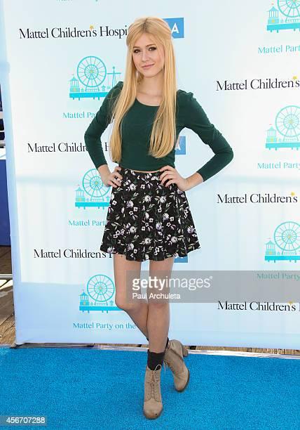 Actress Katherine McNamara attends Mattel's 5th annual Party On The Pier at Santa Monica Pier on October 5 2014 in Santa Monica California