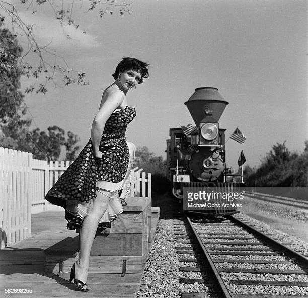 Actress Kathleen Case poses by the railroad steam train during the Opening day of Disneyland in AnaheimCalifornia