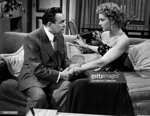 Actress Kathleen Hughes and Edward G Robinson in a scene from the movie The Glass Web