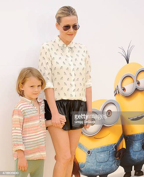 Actress Kathleen Robertson and William Cowles arrive at the premiere of Universal Pictures and Illumination Entertainment's 'Minions' at The Shrine...