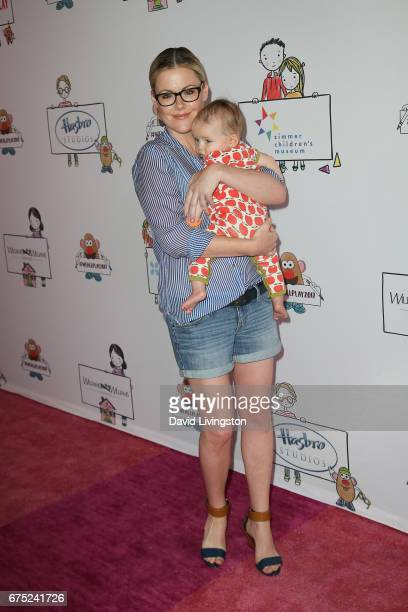 Actress Kathleen Robertson and William Robert Cowles attend the WE ALL PLAY FUNdraiser hosted by the Zimmer Children's Museum at the Zimmer...