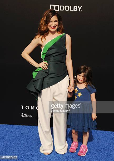 Actress Kathryn Hahn and daughter Mae Sandler attend Disney's 'Tomorrowland' Los Angeles Premiere at AMC Downtown Disney 12 Theater on May 9 2015 in...