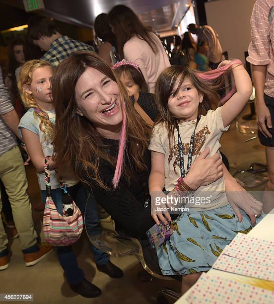 Actress Kathryn Hahn and daughter Mae Sandler attend the premiere of My Little Pony Equestria Girls Rainbow Rocks at TCL Chinese Theatre on September...