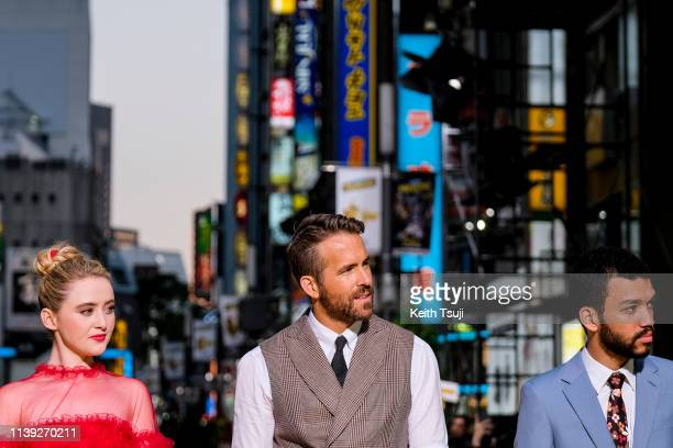 Actress Kathryn Newton actor Ryan Reynolds and Justice Smith attend the world premiere of 'Pokemon Detective Pikachu' on April 25 2019 in Tokyo Japan
