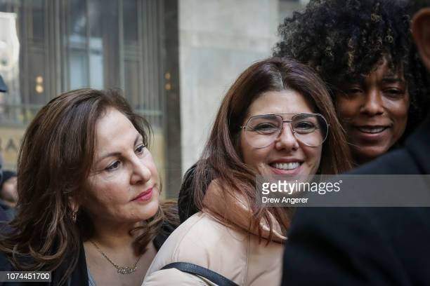 Actress Kathy Najimy and actress Marisa Tomei exit a court hearing for Harvey Weinstein at New York Criminal Court December 20 2018 in New York City...