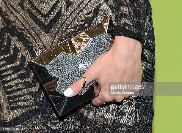 Actress Katie Cassidy clutch purse detail attends The CW Network's New York 2015 Upfront Presentation at The London Hotel on May 14 2015 in New York...