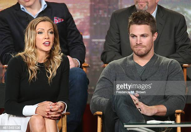 Actress Katie Cassidy speaks as actor Stephen Amell listens onstage during the 'Arrow' and 'The Flash' panel as part of The CW 2015 Winter Television...