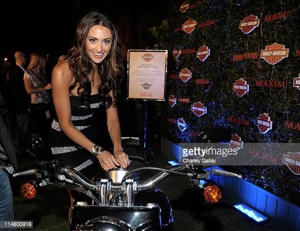 Actress Katie Cleary turns the key on a HarleyDavidson to raise money for Harley's Heroes at the 2010 Maxim Hot 100 Party held at Paramount Studios...