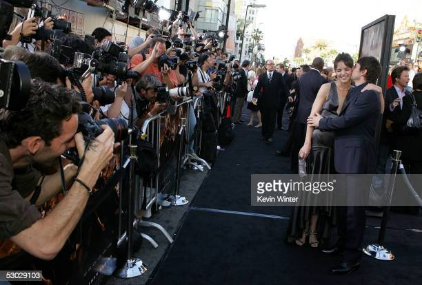 Actress Katie Holmes and actor Tom Cruise arrive at the premiere of Batman Begins at the Graumans Chinese Theater on June 6 2005 in Hollywood...