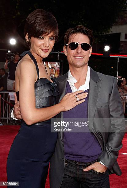 Actress Katie Holmes and actor Tom Cruise arrive on the red carpet of the Los Angeles Premiere of Tropic Thunder at the Mann's Village Theater on...