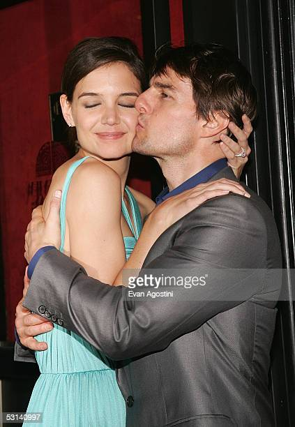 Actress Katie Holmes and actor Tom Cruise attend the premiere of War Of The Worlds at the Ziegfeld Theatre June 23 2005 in New York City