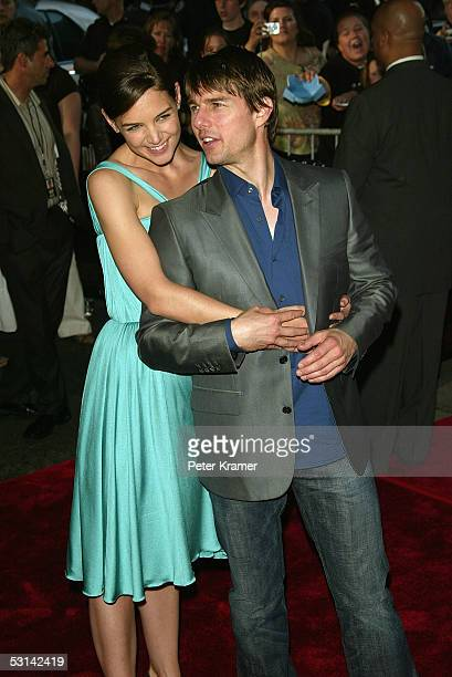 Actress Katie Holmes and actor Tom Cruise attend the premiere of 'War Of The Worlds' at the Ziegfeld Theatre June 23 2005 in New York City