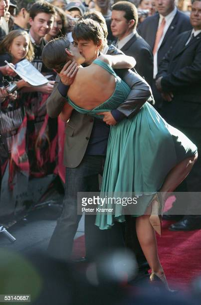 Actress Katie Holmes and actor Tom Cruise kiss at the premiere of War Of The Worlds at the Ziegfeld Theatre June 23 2005 in New York City