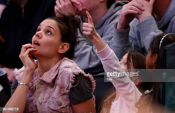 Actress Katie Holmes and her daughter Suri Cruise attend the East Regional Final of the 2014 NCAA Men's Basketball Tournament between the Connecticut...