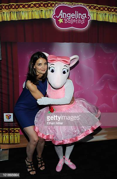 Actress Katie Holmes hugs an Angelina Ballerina costume character as she announces a partnership between her Dizzy Feet Foundation and Hit...