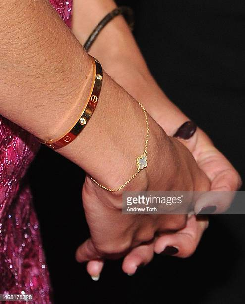 Actress Katie Holmes jewelry detail attends the 'Woman In Gold' New York premiere at The Museum of Modern Art on March 30 2015 in New York City
