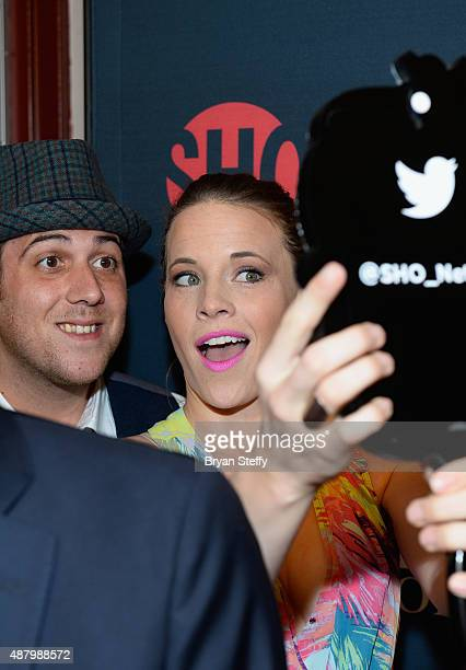 Actress Katie Leclerc poses for a selfie as she arrives at the VIP PreFight Party for 'High Stakes Mayweather v Berto' presented by Showtime at MGM...