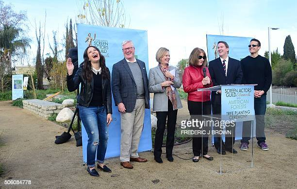 Actress Katie Lowes reacts as she attends a Tree Planting Ceremony and Announcement of a new environmental partnership between the Screen Actors...