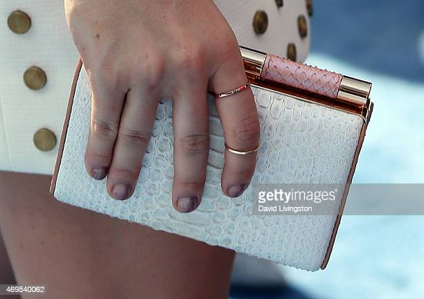Actress Katie Stevens, purse detail, attends the 2015 MTV Movie Awards at the Nokia Theatre L.A. Live on April 12, 2015 in Los Angeles, California.