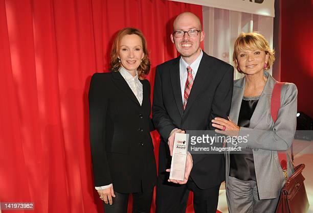Actress Katja Flint, Martin Schlueter and actress Uschi Glas attend the CNN Journalist Award 2012 at the GOP Variete Theater on March 27, 2012 in...
