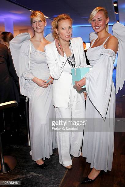 Actress Katja Riemann and angels attend the 'Launch of the BMW Art Advent Calender 2010' at the BMW branch on December 2 2010 in Berlin Germany