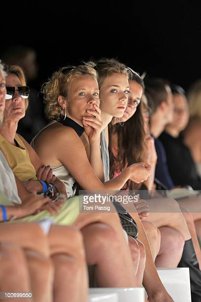 Actress Katja Riemann and daughter Paula sit in front row at the Anja Gockel Show during the Mercedes Benz Fashion Week Spring/Summer 2011 at...
