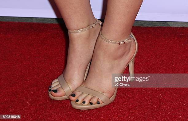 Actress Kayla Maisonet shoes detail attends Latina Magazine's 20th Anniversary Event Celebrating Hollywood Hot List Honorees at STK Los Angeles on...