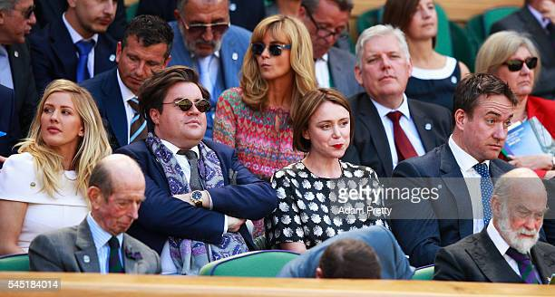 Actress Keeley Hawes Actor Mathew Macfadyen and Ellie Goulding watch on from The Royal Box on day nine of the Wimbledon Lawn Tennis Championships at...