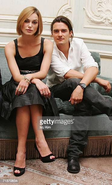 Actress Keira Knightley and actor Orlando Bloom pose at the press junket and photocall for 'Pirates Of The Caribbean Dead Man's Chest' at The...