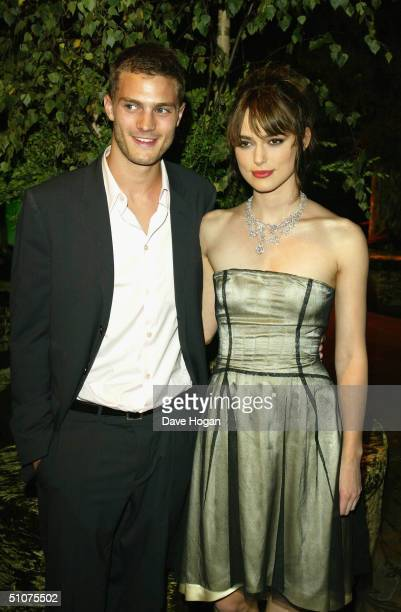 Actress Keira Knightley and boyfriend Jamie Dornan attend the afterparty following the European Premiere of 'King Arthur' at the Guildhall on July 15...
