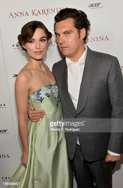 Actress Keira Knightley and director Joe Wright attend the premiere of Focus Features' Anna Karenina held at ArcLight Cinemas on November 14 2012 in...