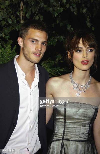 Actress Keira Knightley and her boyfriend Jamie Dornan attend the afterparty following the European Premiere of 'King Arthur' at the Guildhall on...