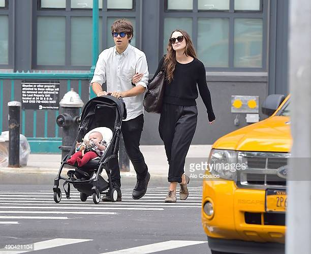 Actress Keira Knightley and her musician husband James Righton stroll with their baby Edie Righton in Soho on September 28 2015 in New York City