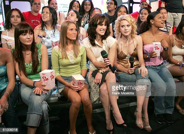 Actress Keira Knightley and TRL VJ Hilarie Burton sit with audience members during MTV TRL Times Square Film Festival Week at the MTV Times Square...