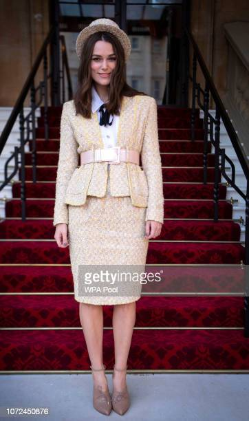 Actress Keira Knightley arrives to receive an OBE for her services to drama and charity at Buckingham Palace on December 13 2018 in London England